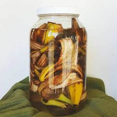 Making banana tea is a great natural fertilizer for any plants. Simply soak the banana peels in filtered water for 3 days to a week, then pour the liquid around your plants and afterwards throw the peels in your compost bin! by estelat Faire Son Compost, Compost Tea, Garden Compost, Vegetable Garden, Water Plants, Garden Plants, Indoor Garden, Indoor Plants, Outdoor Gardens