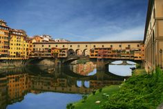 Ponte Vecchio, the oldest of Florence's six bridges, is one of the city's best known images. The shops, housed under the porticos originally belonged to the municipality, then were sold to private owners and began to change through subsequent additions, raised parts and external terraces, extending towards the river and altering the original architecture in an anarchical, suggestive way. #florence #travel #italy #art #tuscany #bridge #pontevecchio