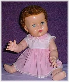 Tiny Tears doll, I had one with molded hair. She wet on Grandpa's favorite chair one early Christmas morning, long, long ago.
