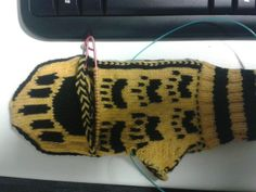 Saw this and just about lost it. Hufflepuff badger paw MITTENS