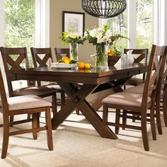 Sawhorse-style dining table with eight matching side chairs.   Product: One table and eight chairsConstruction Materi...