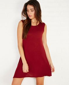 We love basic dresses like this one! Not only can it be dressed up or down, it's perfect for piling on our favorite fall layers. The dress features a super soft knit body, a sharkbite hemline, and a relaxed, swing dress fit.
