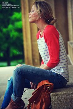 Baseball tee, distressed denim, booties, low bun