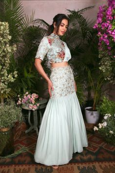 The sublime of this ensemble is the silhouette of the uneven cut waist-belt lehenga intricately deta Indian Fashion Dresses, Indian Gowns Dresses, Dress Indian Style, Indian Designer Outfits, Designer Dresses, Nigerian Fashion, Ghanaian Fashion, Woman Dresses, Indian Wedding Outfits