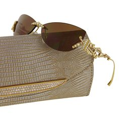 JUDITH LEIBER Gold and Diamond Sunglasses  Gold diamond evening bag