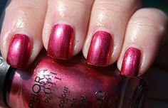 "OPI-""New Year's Red-solution"".  Hard to find a red that works with my skintone.  This works!"