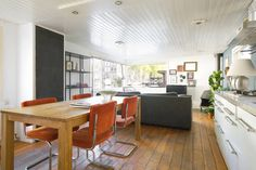 Bright dining area and living area in the back- Houseboat, Amsterdam