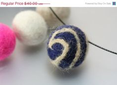 Felted fur ball with your pet's fur.  Dog or cat hair beads.