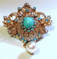 Diamond and turquoise brooch.