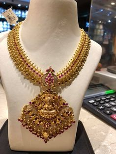 50 grams approx cost 1.8 lakh . Stunning nakshi work necklace with lakshmi devi pendant. Pendant with pumpkin hangings. 11 April 2018
