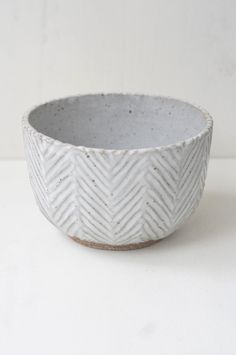 """A deep and generous bowl with a hand-carved herringbone pattern and sheer white glaze. 4""""x6"""""""