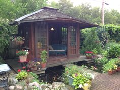 "My ""she-shed"" with pond. Used old doors and windows. Inside used antique shutters as wallpaper. This koi pond tea house is in the middle of the city but you would never know with privacy fence & plantings that are now maturing."
