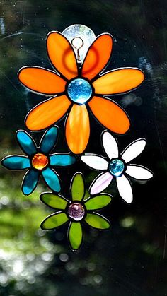 Stained Glass, Multi Colored, Suncatcher, Flower Cluster, Orange Purple Teal, Window Art by miloglass on Etsy https://www.etsy.com/listing/267874424/stained-glass-multi-colored-suncatcher