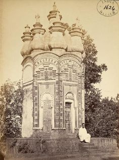 Chandranath Shiva Temple (Hetampur) from the collection of British Library. Photograph of the Chandranatha-Shiva Temple in Hetampur, West Bengal from the Archaeological Survey of India Collections: India Office Series, taken by an unknown photographer in the 1870s. The Chandranatha Shiva temple is an extraordinary example of temple architecture. The octagonal-pinnacled shape is rarely used for temples and creates a striking effect. The exterior panels are heavily carved with geometric…