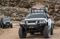 Just a couple of Nissans on the trail. @vegasvuk #crawlandhaul #adventure #adventuremobile #explore #wander #offroad #offroading #tactical #everydaycarry #solidaxle #prerunner #overland #overlanding #crawler #rockcrawler #flex #flexing #4x4 #4wd #nissan #xterra