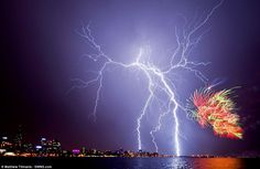 An electrical storm perfectly complements fireworks launched to mark Australia Day 2012 celebrations in Perth, in a stunning shot by Matthew Titmanis.
