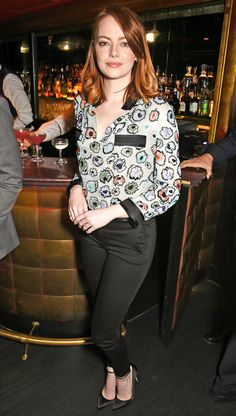 Emma Stone in a printed top and black pants
