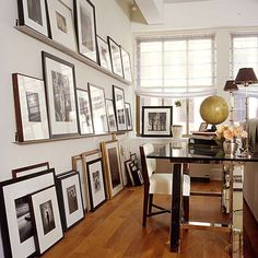 I love the gallery style pictures and the little desk space thats hidden behind the sofa