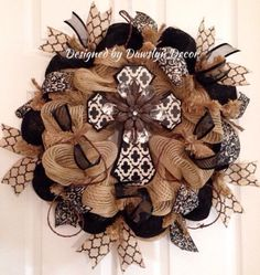 Beautiful burlap colored deco mesh wreath with black and white rustic cross by Dawslyn Decor on Etsy and Facebook.