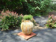 Latest landscaping job, small sneek peek. Jar is planted with creeping phlox.
