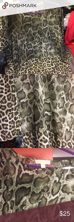 Brand New Micheal Kors flowy top Brand New Micheal Kors flowy top..still ha stag hooks on shirt. Size XL. It is short sleeved sheer and flowy... it's tan and brown with cheetah and snake print. Offers welcomed! Michael Kors Tops Blouses