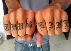 Thug life tattoo fingers