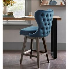 Blue Tufted Back Winged Swivel Stool Light Wood Legs Ceramic Stool, Ceramic Garden Stools, Wood Stool, Blue Furniture, Vintage Furniture, Cowhide Ottoman, Vanity Seat, Velvet Stool, Backless Bar Stools