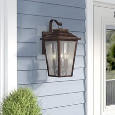 Showcasing a traditional tapered silhouette and a dark bronze finish, this four-light outdoor wall lantern is brimming with classic character. This metal fixture features four incandescent candelabra-base bul Outdoor Lighting Landscape, Outdoor Barn Lighting, Backyard Lighting, Outdoor Wall Lantern, Porch Lighting, Exterior Lighting, Outdoor Walls, Front Door Lighting, Kitchen Lighting