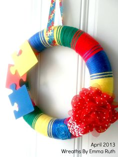 Autism Awareness Yarn Wreath with puzzle pieces red, blue, yellow, green via Etsy