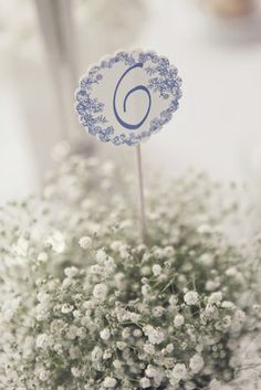 Babies breath centerpiece.  Also love the table number for blue.
