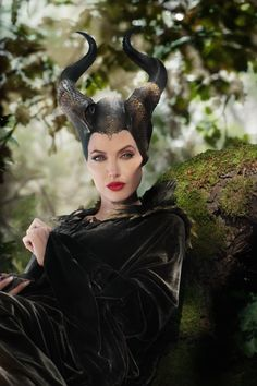 Maleficent this shows her head piece being more reptilian, with the jeweled piece on the forehead