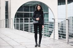 Elisa from the Fashion- and Lifestyleblog www.schwarzersamt.com is wearing a black acne lookalike jacket from H&M grey, a black high waist jeans from weekday, high chelsea boots in black and a black celine trio lookalike bag from C&A. It's a minimal and monochrome style in black.