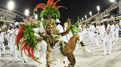 Rio de Janeiro -- Carnival revelers descended on Rio de Janeiro, flocking to hundreds of block parties and cramming into designated areas to watch elaborate parades from dusk until dawn.  Pounding drums and fireworks explosions announced the start of each samba school that parades down the emblematic strip, flanked by stands with seating for 80,000 spectators.