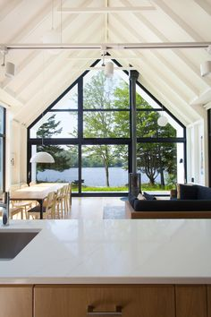 Window on the Lake Cottage in Saint-Élie-de-Caxton by Design by the minimalist Window on a Lake cottage features wood construction both outside and in with a gable roof that makes for optimal views of the water.