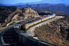 Westbound Union Pacific CITY OF LOS ANGELES-CHALLENGER, passes a freight train as the Domeliner approaches Summit, California, on Cajon Pass, November This stretch of track was abandoned in 1972 in favor of an alignment just south of this location. Union Pacific Train, Union Pacific Railroad, Train Car, Train Tracks, Train Room, Locomotive, Heritage Train, Rare Historical Photos, Train Posters