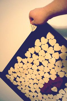 Guest Book Idea: Using wooden hearts instead of paper hearts.