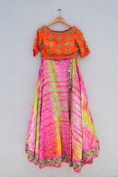 Style:Colored silk patola brocade lehenga with embroidered blouse Fabric:Brocade patola, raw silk, hand embroidery Size:Medium Size customization available!