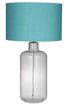 The simplicity of the Petra Table Lamps with their clear glass bottle bases and blue textured shades provides a contemporary vibe be it city or coastal.