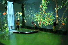 'Funky Forest' is an interactive ecosystem where children create trees with their body and then divert the water flowing from the waterfall to the trees to keep them alive. The health of the trees contributes to the overall health of the forest and the types of creatures that inhabit it. I think this is a really cute and visually impressive way to engage kids.