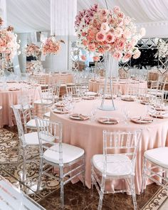 Blush and white luxury wedding reception set up with tall flower centerpieces and blush tablecloths from CV Linens. Click to shop our collection of blush pink wedding linens on a budget! Blush wedding theme decorations for spring weddings on a budget. Beautiful blush wedding reception design with floral table setting and centerpieces. Blush Wedding Reception, Blush Wedding Theme, Blush Pink Weddings, Wedding Pics, Pink Table Decorations, Wedding Venue Decorations, Wedding Decor, Wedding Tablecloths, Wedding Linens