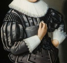 A portrait of a young boy at the age of seven nad three-quarters, standing half-length, wearing a silver satin coat with white lace collar and cuffs   Date : 1591