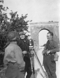 With a beautiful smile, our american filmmaker, Aloha Wanderwell talk's to one of the members of the Wanderwell Expedition as she films Tarragona - Arch Of Triumph, in Spain.
