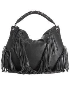 10004da4f969 This black faux leather fringe bag is such a statement piece. Carlos  Santana