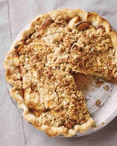 Peach Crumble Pie - With the buttery pastry crust of a pie and the sweet oat topping of a crisp, this dessert proves you really can have it all!