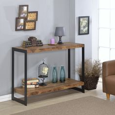 The Industrial console table features a rustic wood finish laminite top with metal sides. The wood and metal design provide functionality and style. Details: Console table Includes hardware Made with Industrial Console Tables, Modern Console Tables, Wooden Console Table, Furniture Deals, Home Furniture, Online Furniture, Furniture Outlet, Furniture Design, Metal Furniture