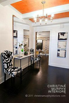 Orange ceiling with white beams and black and white fabric - Christina Murphy