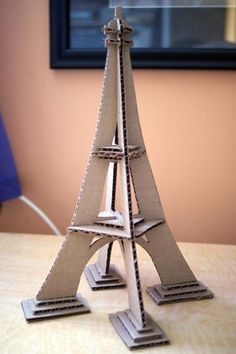 Along with my paintings, I have finished my cardboard model of the Eiffel Tower. It's pretty simple. I'm hoping my teacher appreciates simpl. Cardboard Model, Cardboard Sculpture, Cardboard Crafts, Paris Party, Paris Theme, Eiffel Tower Craft, Ladybug And Cat Noir, Paris Birthday, Newspaper Crafts