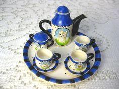 Vintage miniature tea set with cats