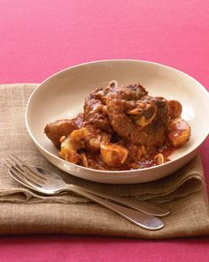 Lamb Shanks and Potatoes | Martha Stewart Living - Take it easy: Your slow cooker or oven can work delicious magic with our lamb dinner to fix and forget.