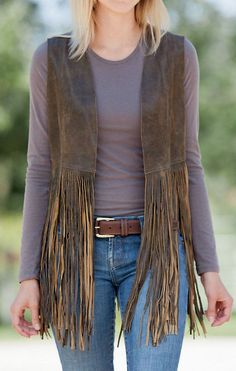 Wherever you're headed, do it in chic Western style in the Sonia Fringed Lambskin Leather Vest. Crafted from Middle Eastern lambskin leather...